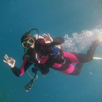 Lexi's buddy enjoying her dive! #PADI20Millionth