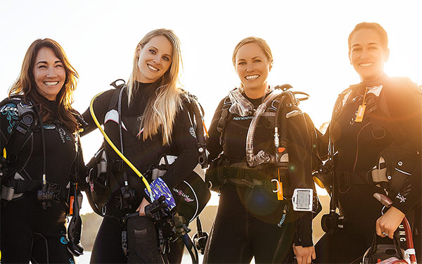 padi-women-scuba-divers-wetsuits