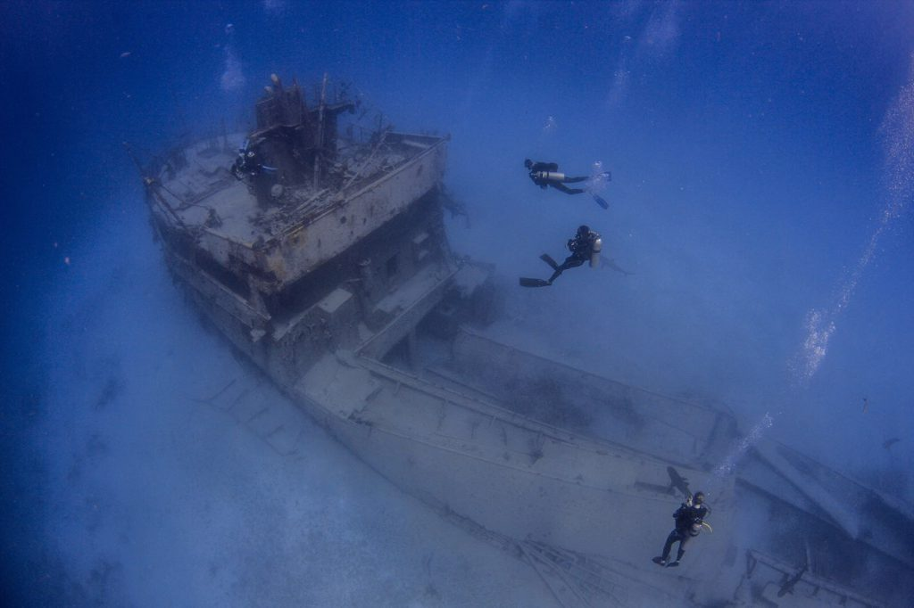 Liz Parkinson and crew diving in the Bahamas after the hurricanes. Photo: Pia Venegas